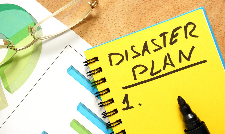Notepad with disaster plan.