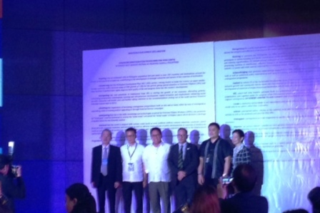Secretary Silvestre Bello III of the Department of Labor and Employment (third from left), and other government officials stand in front of the Reintegration Summit Declaration.